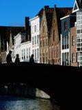 Pedestrians Crossing Canal and Houses Near Jan Van Eyckplein  Bruges  Belgium