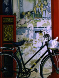 Bicycle Against Muralled Wall of Chinese Temple at Marudi  Sarawak  Malaysia
