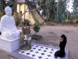 Woman Praying to Buddha  Vinh Trang Pagoda  My Tho City  Vietnam