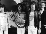 Rolling Stones Bill Wyman  Mick Jagger  Ronnie Woods Charlie Watts Beside Poster of Keith Richards