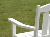White Wooden Chair Against Green Grass