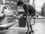 The Modern Female Petrol Pump Operator Refuelling a Car in Her Mini Skirt