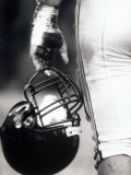 Low Angle View of An American Football Player Holding a Helmet