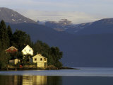 Mountain and Houses Reflecting in Fjord Waters  Norway