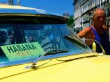 Man with 1950's Taxi  Havana  Cuba