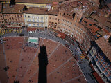 Bustle of Il Campo From Top of Torre Del Mangia  with Tower Shadow Across Square  Siena  Italy