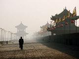 Man Walking on Ancient Wall Near North Gate  Xi'An  China