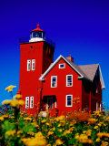 Bright Red Two Harbors Lighthouse with Flowers in Foreground  Lake Superior  Two Harbours  USA
