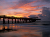 Pier at Sunrise with Reflections of Clouds on Beach  Tybee Island  Georgia  USA