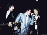 Musicians George Harrison  Bruce Springsteen and Mick Jagger Performing Together
