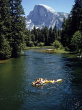 Tourists Float on a Raft in the Merced River at Yosemite National Park