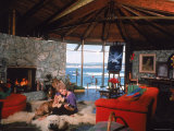 Actress Kim Novak Playing Guitar Beside Pet Great Dane Warlock at Her Home in Big Sur