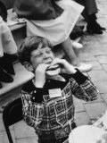 Hollywood Child Timmy Garry at Children's party Dressed in Cowboy Outfit eating a Hamburger