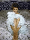 Actress Sophia Loren Wearing Feather Boa Posing in Her Bedroom