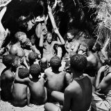 Chief Acts Out a Story to Bushman Children  Southern Kalahari Desert in Central Southern Africa