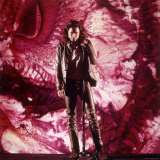 Rock Star Jim Morrison of the Doors Singing Alone on Stage in Front of a Psychedelic Backdrop