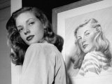Actress Lauren Bacall Posing in Front of Portrait Drawing of Herself in Suite at the Gotham Hotel