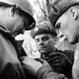 Pair of Russian Soldiers Exchanging Insignia with an American Army Captain