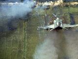 American F4C Phantom Jet Firing Rockets into Viet Cong Stronghold village During the Vietnam War