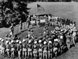Boys in Circle for Ceremony Before Playing Young American Football League Games