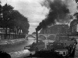 River Boat Smoke Passes along the River Seine