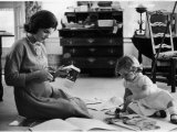 Jackie Kennedy  Wife of Sen  Cutting Out Newspaper Clippings Next to Open Scrapbook