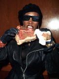 Singer Grace Jones Putting Raw Steak to Mouth
