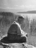 Swiss Psychiatrist Dr Carl Jung Sitting on Stone Wall Overlooking Lake Zurich