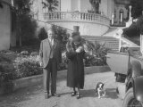 William Randolph Hearst and Mrs Burton Holmes at San Simeon Estate with Boston Bull Terrier