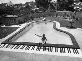 Liberace at the 'Piano' Shaped Pool in His Home