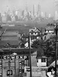 Lower Manhattan and Ferry Docks with Aid of a Telephoto Lens over the Rooftops in Staten Island