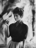 Actress Sophia Loren Examining a Tiny Flower Outside