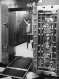 Bank Employee Selecting a Safety Deposit Box for a Customer Inside Vault Area