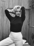 Actress Marilyn Monroe Playfully Elegant  at Home