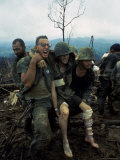 American Marines Aid a Wounded Comrade During Intense Battle for Hill 484