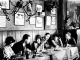Patrons at a Prohibition Protected Speakeasy Popular for Drinking Aviators