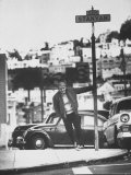 Poet Rod McKuen Swinging from Sign Which is Title of One His Songs  Stanyan Street