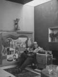 Architect Le Corbusier Sitting in Chair with Book in Hands  Glasses Perched on His Forehead
