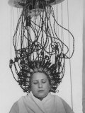 Woman at Hairdressing Salon Getting a Permanent Wave
