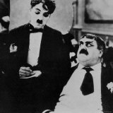Charlie Chaplin with Eric Campbell in The Rink Photo premium
