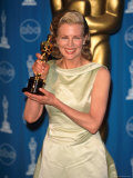 Kim Basinger Holding Her Oscar in Press Room at Academy Awards