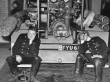 London Auxiliary Fire Service Crew Members Catch Nap on Tail of a Fire Truck
