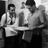 """Director Walt Disney Looking over Sketches from His Latest Picture """"Pinocchio"""""""