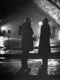 """Carol Reed Coaching Orson Welles as They Stand Against Floodlights During Filming """"The Third Man"""""""