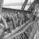 German Soldiers Walk over Elbe River to Surrender to Allied Forces in the Waning Days of WWII