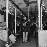 Activist Folk Musician Woody Guthrie Playing for a Subway Car of New Yorkers