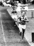 Distance Champion Emil Zatopek as He Set a New 10 000 Meter Record During the Olympic Games