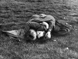 American Soldier and English Girlfriend Blissfully Embracing on Lawn in Hyde Park