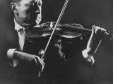 Close Up of Violinist Jascha Heifetz Playing in Mili's Darkened Studio