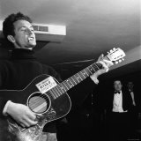 """Folk Singer Woody Guthie Performing with Guitar Emblazoned with """"This Machine Kills Fascists"""""""